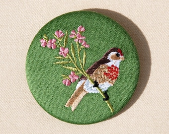 Large lined Linnet on floral branch and bird brooch