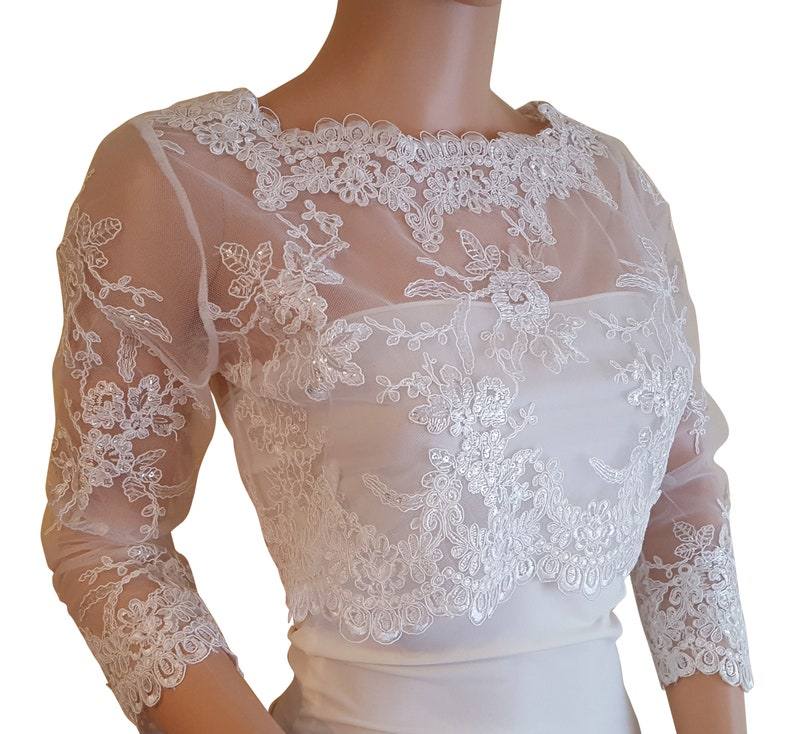 v back bolero with 34 length sleeves with a button fastening detail  back size UK 8-18 fullly lined Pale Ivory cropped sequined lace