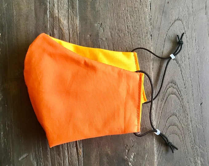 Reusable quality cotton face mask with adjustable ear elastic for a custom fit. Made in USA