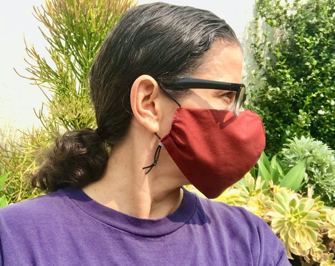 Quality handmade cotton face mask with adjustable ear elastic for a custom fit. Made to last in the USA.
