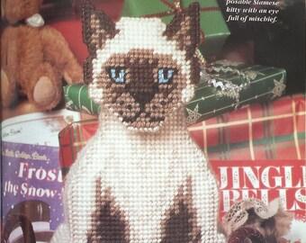 Plastic canvas pattern book, Santa Surprises stitching chart hardback book dated 1997, Christmas plastic canvas pattern