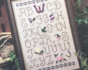 Counted cross stitch pattern, All Things Beautiful Sampler, Leaflet 873 dated 1990, cross stitch chart, alphabet sampler