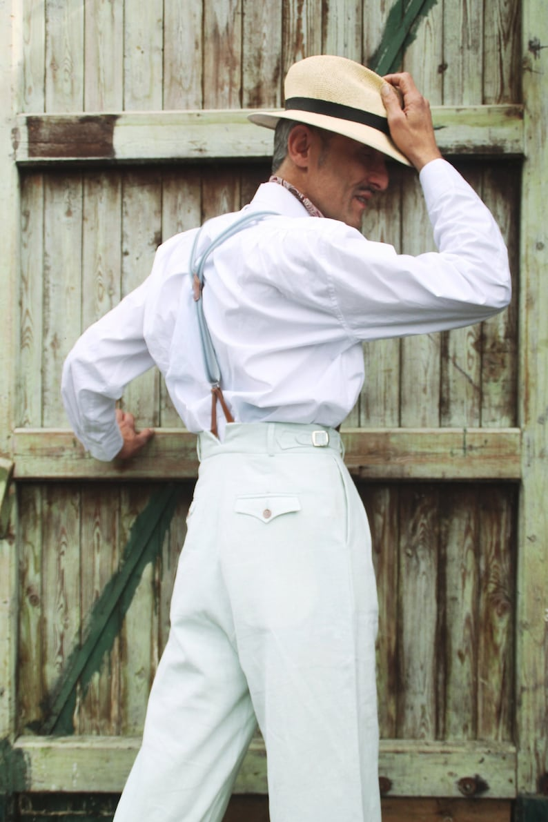 1920s Men's Pants History: Oxford Bags, Plus Four Knickers, Overalls     Read the full title    high waist trousers in powder blue linen with reverse pleats vintage style $265.93 AT vintagedancer.com