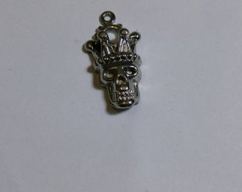 Metal skull in a crown charm