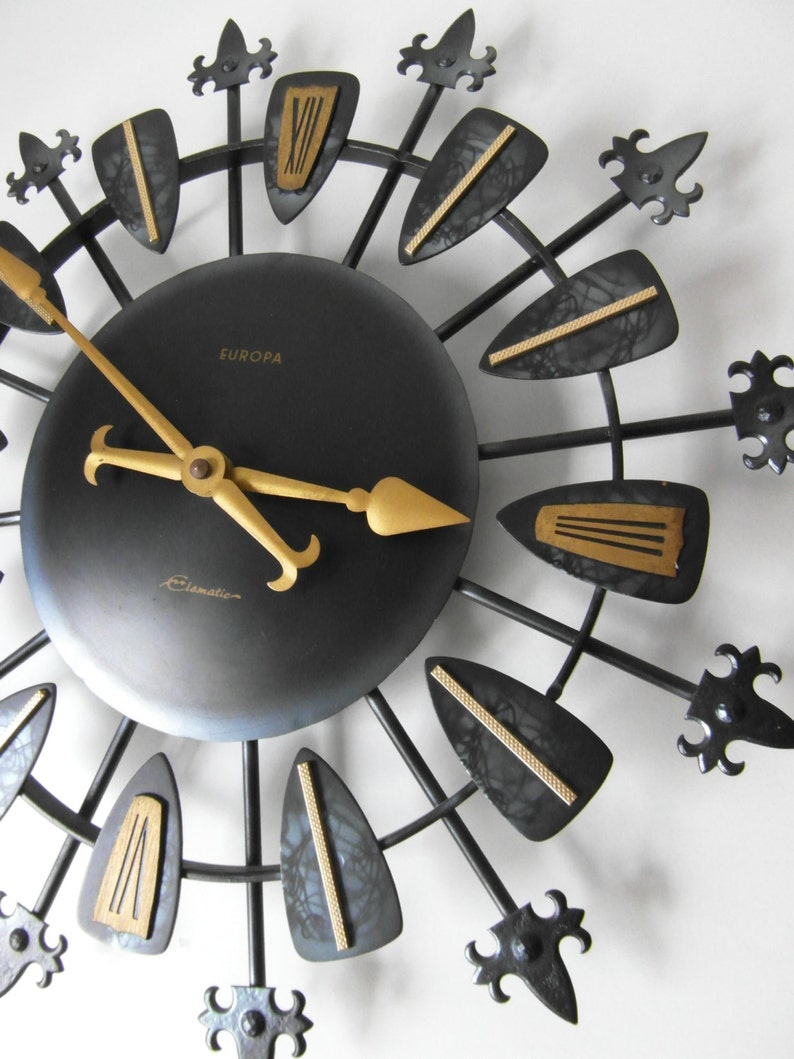 SALE wall clock EUROPA Elomatic Elomatics - 60s West German black gold metal