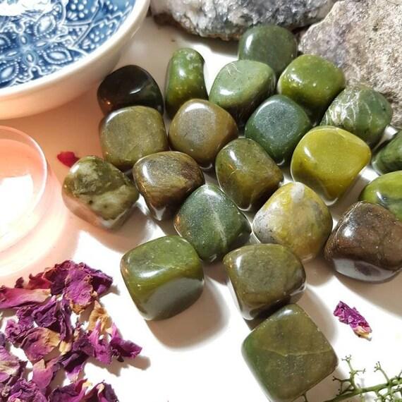 Green and black Jade tumble stone