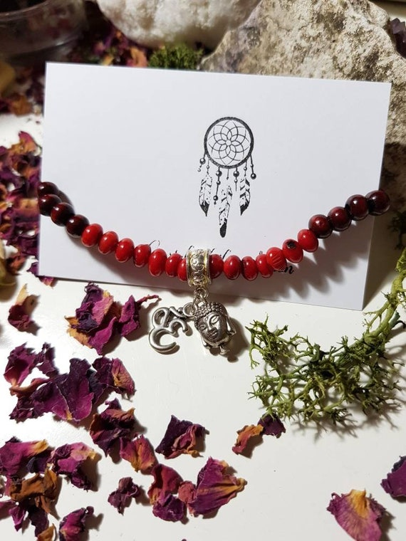 Red Coral and wooden beaded elastic bracelet with Buddha and OM charm