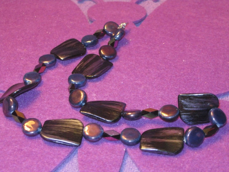 Shades of PURPLE with Hint of BLACK and IRREDECENT Retangles