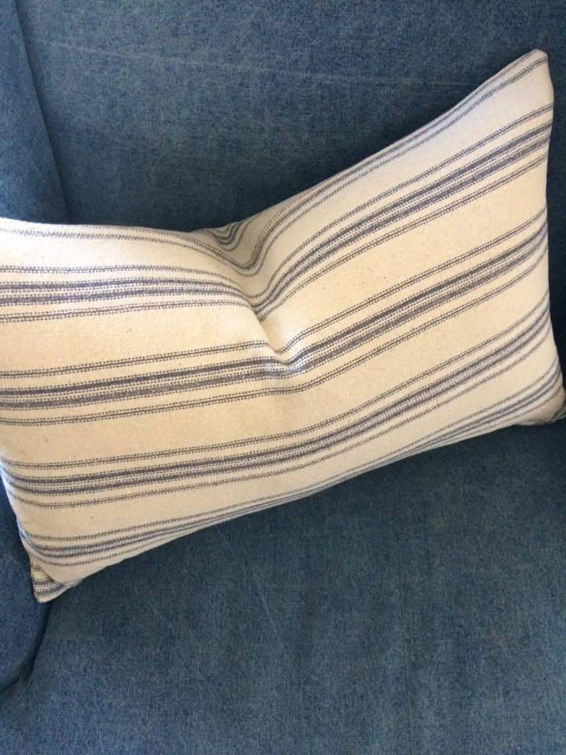 Blue and white stripe grainsack lumbar pillow. #grainsack #vintagegrainsack #pillow