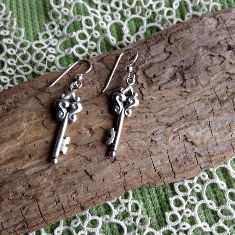 Silver Skeleton Key Drop Earrings made in Alaska cast in image 0