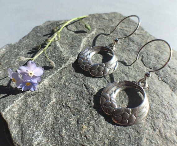 Silver Mobius Wings earrings, made in Alaska, cast in eco friendly reclaimed sterling silver, on sterling ear wires
