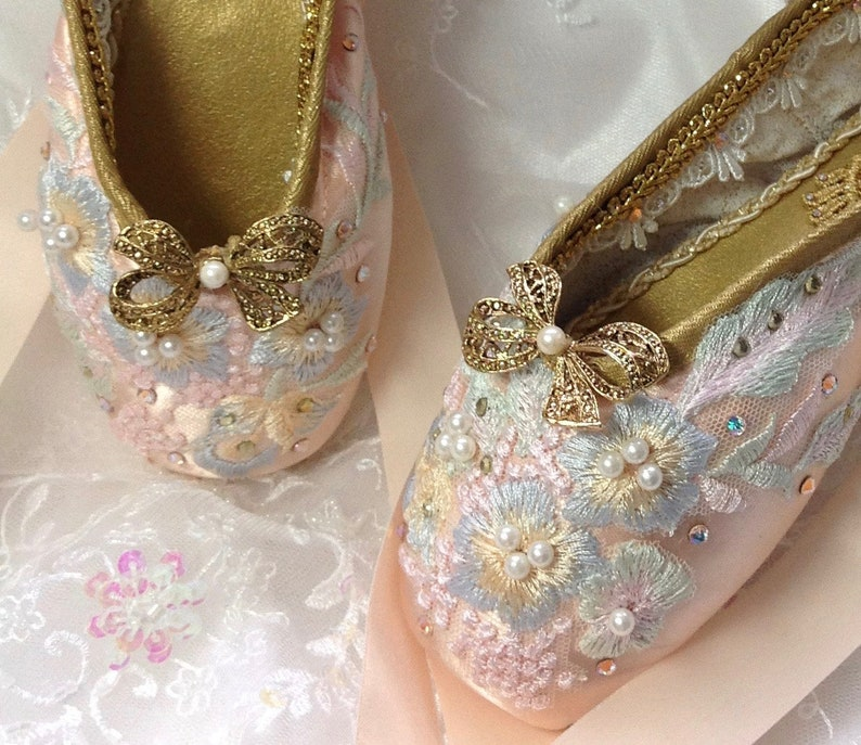 dac6a2f1e329d3 PAIR of pink and gold decorated pointe shoes. Sugarplum Fairy.