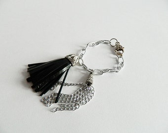 Leather and silver chain fringe bracelet to give an edgy look to any outfit