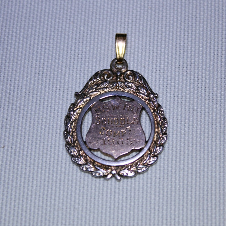Sterling Silver and Rose gold Medal