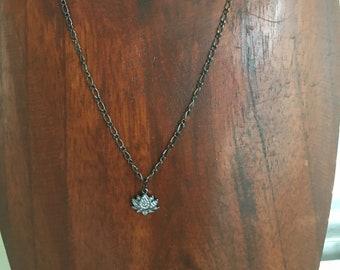 Gunmetal lotus necklace with cz's