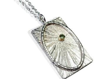 Silver, peridot and 18ct Gold pendant