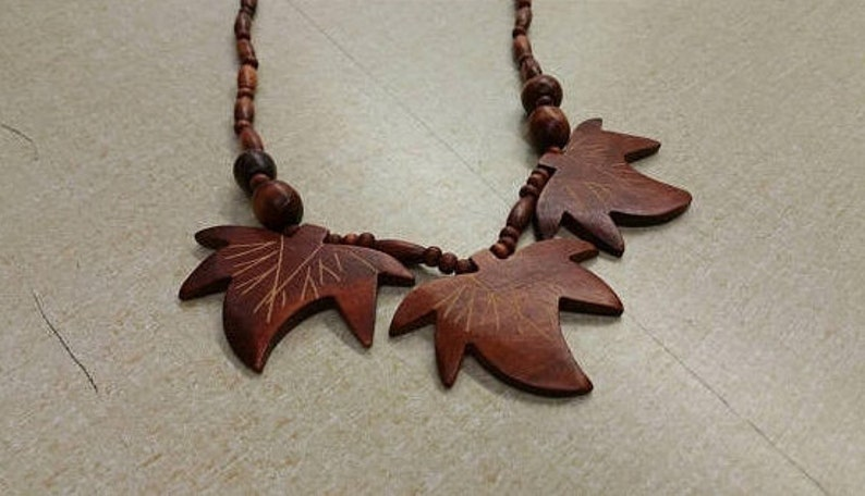 On Sale Metal Free Boho Style Dark Wooden Beaded Leaf Design image 0