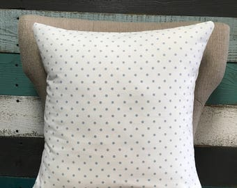 Polka dot pillow with weathered blue dots.
