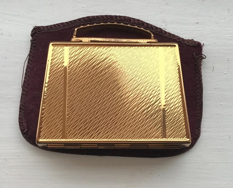 Gorgeous 1950\u2019s Mascot handbag or luggage shaped compact