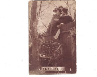 Antique, Early 1900s Humorous Postcard, Posted with 1 Cent Stamp, Black & White Photo of Couple's Escape Over Fence Vintage Postcard