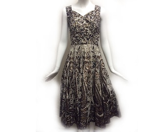 Vintage 50s Cotton Black Beige Abstract Swirl Foliage Print Sweetheart Neckline Fit n Flare Midi Dress w Bronze Glitter Embellishment