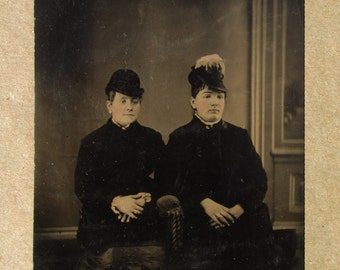 Two Women - tin-type photograph.  It's the oddest thing...