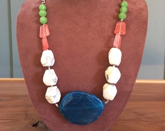 The Wilma necklace: blue agate, howlite beads, red veined quartz beads, and bright green glass beads, 24 inches long