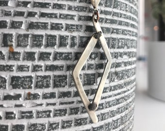 "The ""Bryonee"" necklace pendant, mixed media of grey thread and sterling silver"