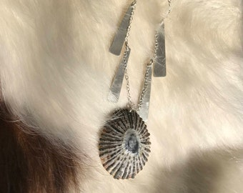 The Rachel necklace made of Hawaiian shell, silver chain and silver charms