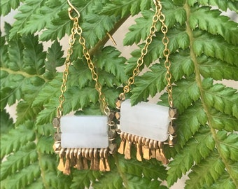 "The white jade and brass faceted bead ""Carmine"" earring has irregular length handforged gold-fill wire fringe, gold chain and gold earwire"