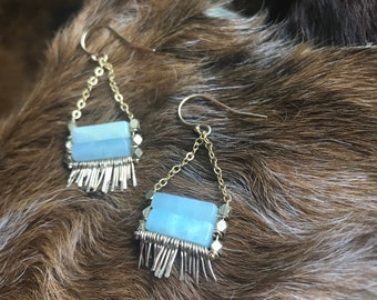 "The blue amazonite and brass faceted bead ""Carmine"" earring has irregular length handforged gold fringe, gold chain and gold earwire"