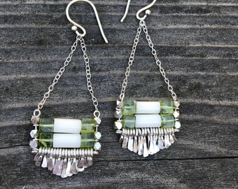 "The white coral and peridot bead ""Carmine"" earring has gradient length hand forged silver fringe, silver chain and silver fishhook"
