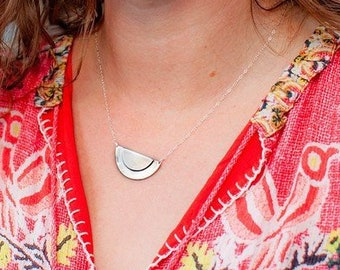 The Adrian necklace of two half circles layered up on the necklace pendant large size
