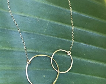 """The 20"""" long Lydia necklace is made of two 14k gold fill interlocking similarly sized circles connected to a 14k gold fill chain"""