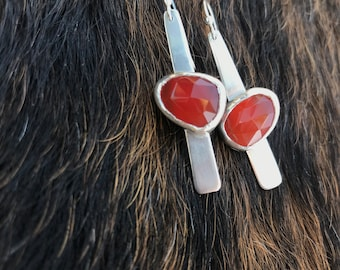 "The ""Dana"" earring,  two orange carnelian stones set on a strip of sterling silver fringe"