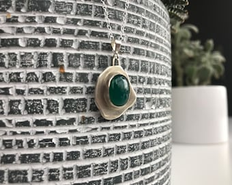 "The ""Ingrid"" green onyx stone necklace pendant with an oval and irregular shaped base and 18inch silver chain"