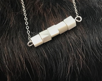 "The ""Candace"" necklace is delicate and short made of silver chain necklace with five small mother of pearl cube beads"
