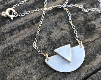Adrian bib necklace: half circle with a triangle layered atop made of sterling silver with silver chain smaller version