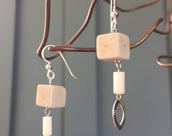 "The ""Dora"" earring: a short pillar of cream white sandstone and coral beads with an eye shaped silver filagree and sterling silver fish hook"
