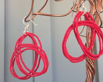 "The ""Libby"" earring: Three woven, beaded strands of red"