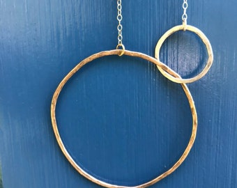 The Lydia necklace is one large 14k gold fill one small silver interlocking circle with half a sterling sliver half gold chain, 20 1/2 inch