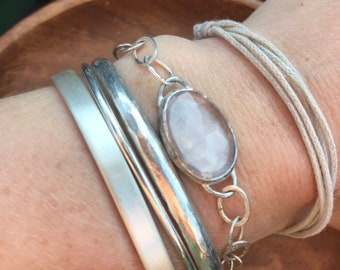 "The ""Alicia"" handmade chain link and set rose quartz stone bracelet measuring 6 3/4 length closed with a toggle clasp"