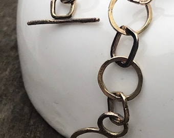 Alicia bracelet 12k gold fill circle and square link metal bracelet with toggle clasp closure