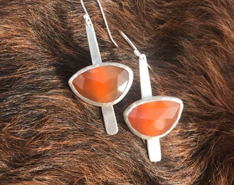 """The """"Dana"""" earring, each is 7.6 carates of orange chalcedony stone set on a strip of sterling silver fringe"""