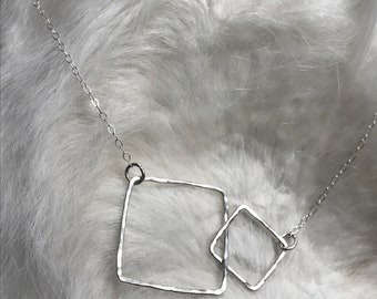 "The 20"" long Lydia necklace is made of two sterling silver interlocking squares of contrasting size connected to a sterling sliver chain"