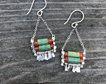 "The turquoise and orange carnelian bead ""Carmine"" earring has hand forged silver fringe with silver chain and silver fishhook"