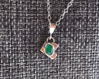 "The ""Ingrid"" green onyx pendant with an angular and irregular shaped metal baseplate"