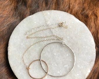 """The 18"""" Lydia necklace is one large 14k gold fill one small silver interlocking circle with half a sterling sliver half gold chain"""