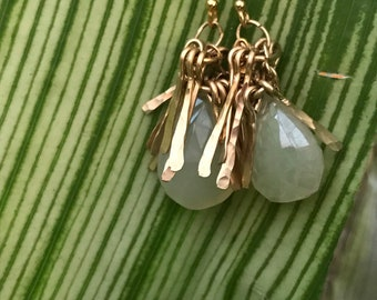 "The ""Gertrude"" earring is a tassel made of hand forged 14k gold fill fringe topping white chalcedony briolette stone bead and earwires"