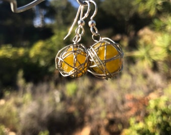 Leesa earring: Recycled yellow glass bead wrapped with silver plated wire and sterling silver earwire